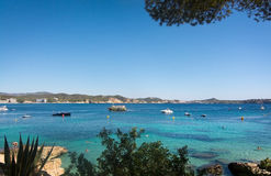 Cala Fornells beach. CALA FORNELLS, MALLORCA, SPAIN - SEPTEMBER 6, 2016: Green water beach, bathers and boats on a sunny day on September 6, 2016 in Cala royalty free stock photos