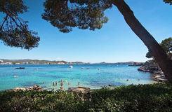 Cala Fornells beach. CALA FORNELLS, MALLORCA, SPAIN - SEPTEMBER 6, 2016: Green water beach, bathers and boats on a sunny day on September 6, 2016 in Cala stock image