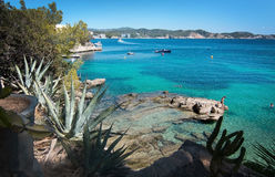 Cala Fornells beach. CALA FORNELLS, MALLORCA, SPAIN - SEPTEMBER 6, 2016: Green water beach, bathers and boats on a sunny day on September 6, 2016 in Cala stock images