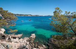Cala Fornells beach. CALA FORNELLS, MALLORCA, SPAIN - SEPTEMBER 6, 2016: Green water beach, bathers and boats on a sunny day on September 6, 2016 in Cala stock photos