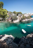 Cala Fornells beach. CALA FORNELLS, MALLORCA, SPAIN - SEPTEMBER 6, 2016: Green water beach, bathers and boats on a sunny day on September 6, 2016 in Cala royalty free stock photography