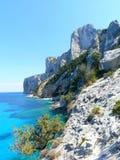 Cala Goloritze. Cliffs that hangs over sardinian sea Stock Images