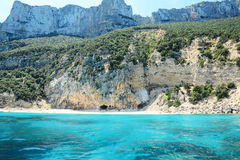 Cala Gonone coastline seen from the sea. Shot in Sardinia, Italy Royalty Free Stock Image
