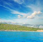 Cala Gonone shore under clouds Royalty Free Stock Images