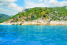 Cala gonone shoreline on a cloudy day Royalty Free Stock Photo