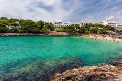 Cala Gran beach with turquoise water crowded with tourists in Mallorca. Spain Royalty Free Stock Images