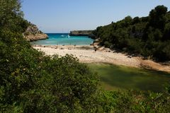 Cala Magraner - Mallorca. Cala Magraner beach on the east coast of Mallorca, Spanish Balearic island. There is also a climbing wall on the left side of the beach Stock Image