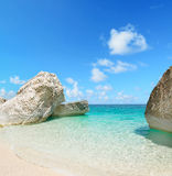 Cala Mariolu rocks under a clear sky. In the summer Stock Images