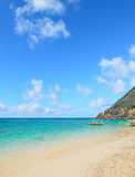 Cala Mariolu shoreline under clouds Stock Photo
