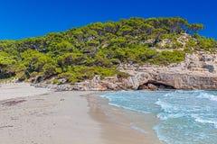 Cala Mitjana Beach on Sunny Day royalty free stock photo