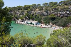 Cala Pi beach. MALLORCA, SPAIN - AUGUST 7, 2018: Cala Pi beach with tourists on a sunny summer day on August 7, 2018 in Mallorca, Spain royalty free stock photos