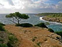 Cala Pi Point. Cala Pi takes its name from the pine trees that surround it and from the torrent that flows into its waters. The Tower of Cala Pi, built in 1663 stock images