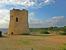 Cala Pi Tower. Cala Pi takes its name from the pine trees that surround it and from the torrent that flows into its waters. The Tower of Cala Pi, built in 1663 stock photo