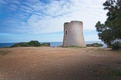 Cala Pi tower Mallorca. Cala Pi tower and ocean view horizon towards Cabrera island Mallorca, Spain stock photo