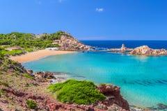 Cala Pregonda beach at Menorca. Cala Pregonda beach with golden sand on summer sunny day at Menorca island, Balearic islands, Spain royalty free stock images