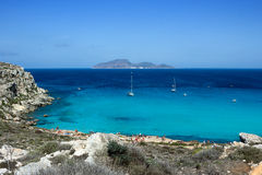 Cala Rossa, crystalline turquoise sea, famous beach in Favignana, Sicily Stock Photography