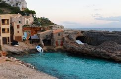Cala s`Almunia in Mallorca island, Spain. Cala s`Almunia, beach with small fishermen houses Mallorca. Spain Stock Photo