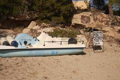 Rental paddle boat. Cala Tarida, Ibiza, Balearic Islands - August 28, 2014 : Paddle boat renting stock photo