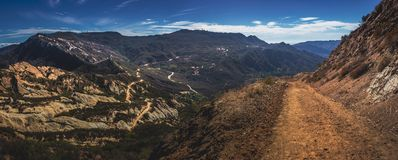 Calabasas Peak Trail Panorama. Picturesque overlook of Calabasas Peak Trail winding through the canyon with rock formations on a sunny day with blue sky and Royalty Free Stock Image