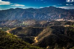 Calabasas and Santa Monica Mountains. Scenic overlook of Calabasas with the Santa Monica Mountains in the background on a sunny day with blue sky and clouds Stock Photo