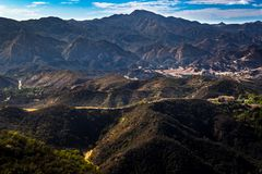 Calabasas and Santa Monica Mountains. Scenic overlook of Calabasas with the Santa Monica Mountains in the background on a sunny day with blue sky and clouds Stock Images