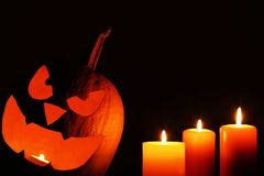 Calabaza de Halloween con las velas Imágenes de archivo libres de regalías