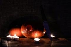 Calabaza de Halloween con una nariz roja Imagen de archivo libre de regalías