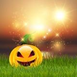 Calabaza de Halloween en hierba Imagen de archivo