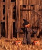Calabaza del espantapájaros delante del granero viejo fotos de archivo