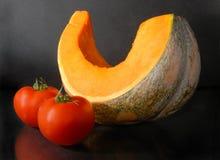 Calabaza y tomates Foto de archivo libre de regalías