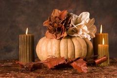 Calabaza y velas Imágenes de archivo libres de regalías
