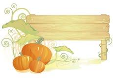 Calabazas de otoño con la muestra de madera Fotos de archivo