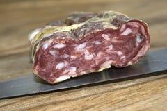 Calabese soppressata. Traditional calabrese speciality: soppressata salami stock photo