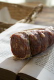 Calabrese fiery soppressata. Calabrese soppressata a fiery brawn made in Calabria on an old book royalty free stock images