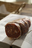 Calabrese fiery soppressata. Calabrese soppressata a fiery brawn made in Calabria on an old book royalty free stock photography