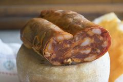 Calabrese soppressata laid on a whole cheese Stock Images