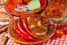 Calabria, locale food. The south Italy, Calabria, locale food - soft sausage nduja, peper, tomato, cheese royalty free stock image