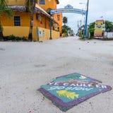 CALAFATE DE CAYE, BELICE - 20 DE NOVIEMBRE DE 2017: Huelga intermitente de la muestra de la isla del calafate de Caye fotografía de archivo libre de regalías