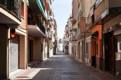 Calafell resort town, Spain. Street view. Calafell, Spain - August 13, 2014: Calafell resort town in Tarragona region, Catalonia, Spain. One way street Royalty Free Stock Image