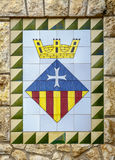 Calafell town Coat of arms on the old stone wall, Catalonia, Tarragona. Calafell, Spain - May 22, 2016: Calafell town Coat of arms on the old stone wall Royalty Free Stock Images