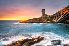 Calafuria Tower landmark on cliff rock, aurelia bridge and sea o Royalty Free Stock Photo