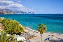 Calahonda Beach in Nerja on Costa del Sol. Nerja, resort town on Costa del Sol in Andalucia, Spain, Calahonda beach at Mediterranean Sea Royalty Free Stock Image