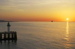 calais france över havssolnedgång Royaltyfri Bild