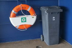 CALAIS, FRANCE, AUGUST 10 2016: Life belt and waste bin on the cross channel ferry to France Stock Photos