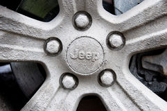 Mud covered Jeep rim Stock Image