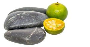 Calamansi and Zen Stones II Stock Photo