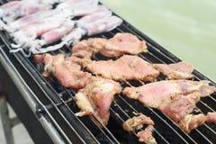 Calamares e carne de porco grelhados Foto de Stock