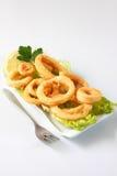 Calamari. Deep fried calamari with lettuce and lemon Stock Photos