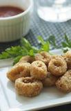 Calamari Appetizer. Breaded and deep fried calamari rings with marinara sauce Stock Photos