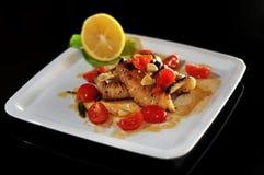 Calamari avec des tomates Photo stock